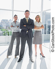 Portrait of confident business people standing together