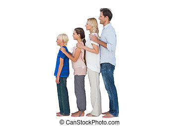 Family posing together on white background