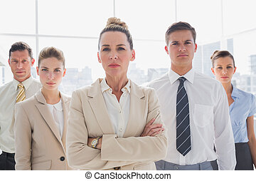 Group of serious business team standing together