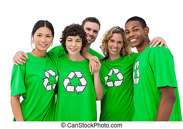 Group of people wearing green shirt with recycling symbol on...