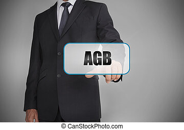 Businessman selecting tag with agb written on it on grey...