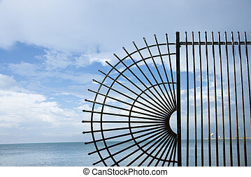 Wrought iron fence by ocean - Decorative wrought iron fence...