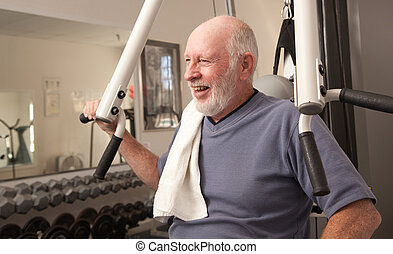 Senior Adult Man in the Gym - Senior Adult Man Working Out...