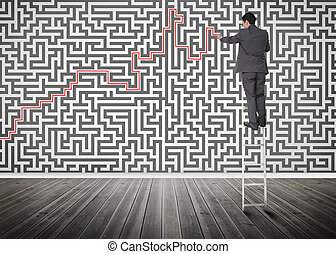Businessman standing on a ladder solving maze puzzle in an...