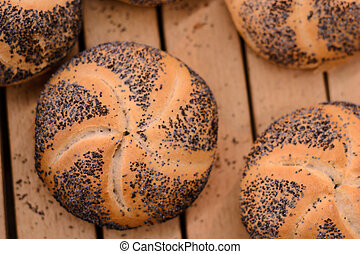 Brad rolls with the poppy seeds on the box