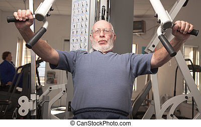 Fit Senior Man in Gym