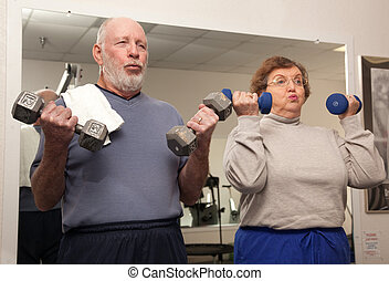 Elderly Couple Work Out - Senior Adult Couple Working Out in...