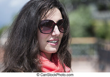 young Italian woman with sunglasses and scarves