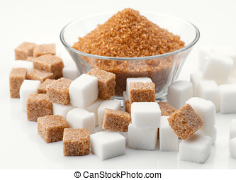 bowl of brown sugar and brown and white sugar cubes surround
