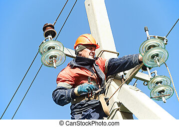 power electrician lineman at work on pole - Electrician...