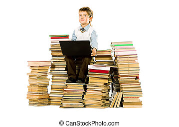 primary school - A boy sitting on a pile of books with a...