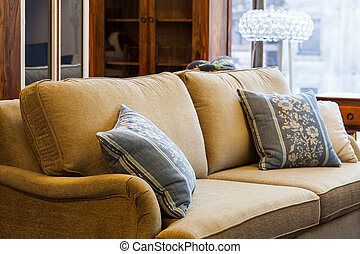 Light brown sofa - A light brown sofa with blue and cream...