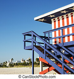 Stars and stripes building. - Lifeguard tower painted red,...