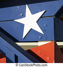 Red, white and blue. - Close-up of lifeguard tower painted...