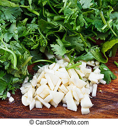 chopped garlic, parsley and cilantro - fresh spicy herbs -...