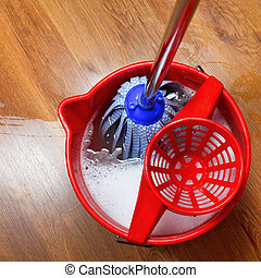 mop in bucket with water - top view of mop in bucket with...