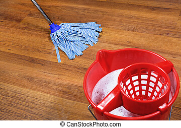 mopping of parquet floors - red bucket and mopping of...