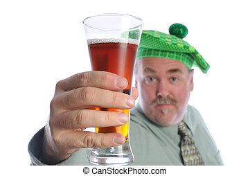 St Patrick dirnk - man having drinks for st patric day