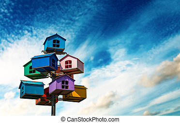 Nesting boxes - Colorful nesting boxes on blue sky