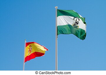 Spanish and Andalucian Flags on blue sky