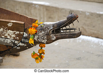 old wooden boat with animal head in Varanasi,India - old...