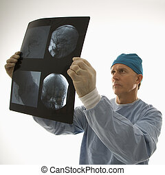 Doctor reading x ray.