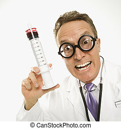 Scary doctor. - Mid-adult Caucasian male doctor wearing...