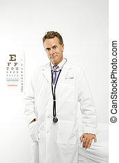 Doctor with eye chart.