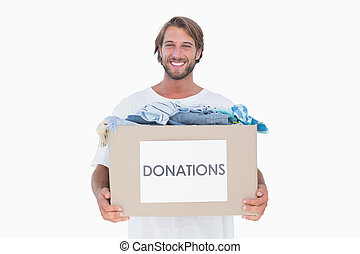 Happy man carrying donation box