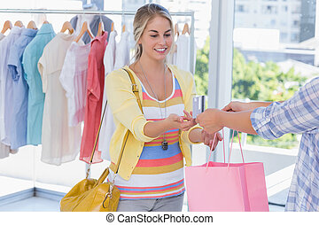 Attractive customer receiving her credit card and shopping...