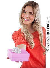 Blonde woman offering a present