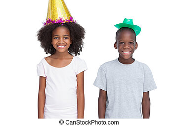 Kids wearing party hats on a white background