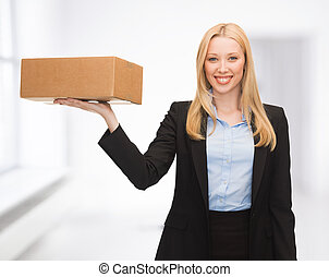 businesswoman delivering cardboard box - attractive young...