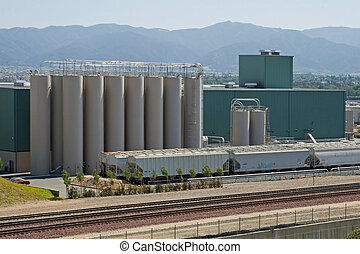 Manufacturing Plant - The modern silos of a manufacturing...