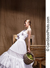 Portrait of  Fashion studio shot woman in Wedding dress. Professional makeup and hairstyle