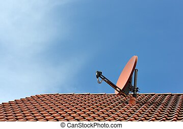 Satellite Dish - A satellite dish on a house roof