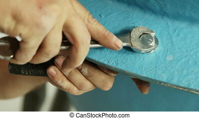 Tightening the nuts on the big blue tube Mens hand tighten...
