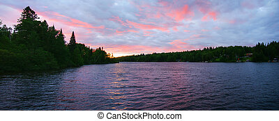Sunset on the lake - Panorama of pink sunset on a northern...