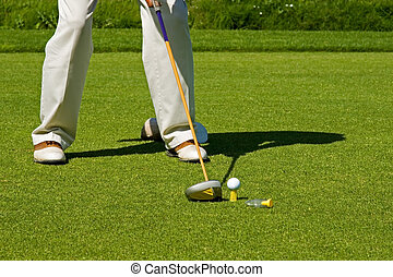 Playing Golf - Golf course action and players hitting the...