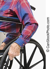 Man in wheelchair - Caucasion male elderly hands gripping...