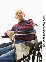 Elderly man in wheelchair.