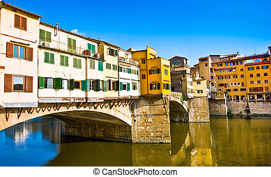 Famous Ponte Vecchio with river Arno at sunset in Florence,...
