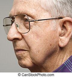 Portrait of elderly man. - Close-up profile portrait of...