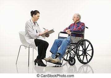 Doctor and patient - Mid-adult Caucasian female doctor...