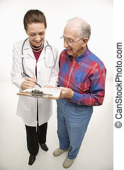 Physician and patient. - Mid-adult Caucasian female doctor...