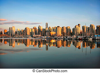 Beautiful view of Vancouver skyline with harbor at sunset,...