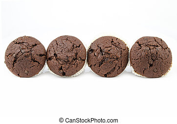 Chocolate muffins isolated on white
