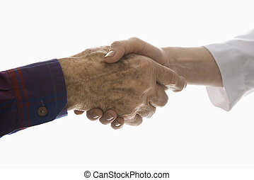 Shaking hands - Close-up of elderly Caucasian male shaking...