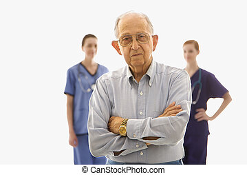 Man with healthcare workers.