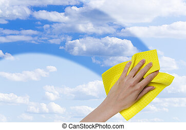 clear blue sky - hand cleaning window making it easier to...
